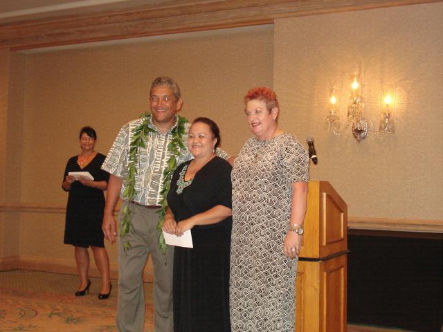 Pictured:  Big Island Mayor Billy Kenoi presents check to AILH ED Roxanne Bolden and Big Island Senior IL Specialist, Sam Nagasawa.