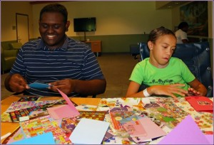 Two children at Shriner's making cards with Hui Malama Po`o