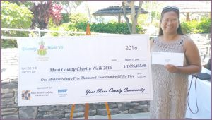 Lani Cabanilla with check from Maui Charity Walk