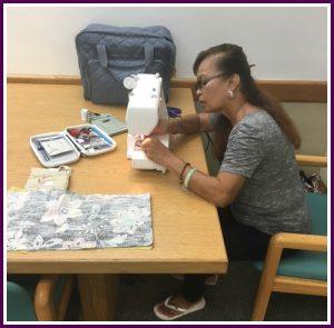 Photo of Mary sewing new handbag