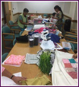 Photo of Liv! Zentangles members sorting fabric