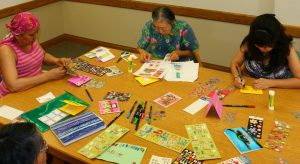 Photo of Hui Malama Po`o members making cards
