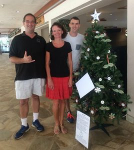 Photo of Brian, Kathleen, and Christopher in front of tree
