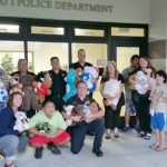 Photo of AILH and volunteers dropping off stuffed animals at HPD