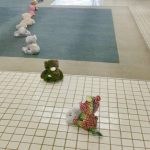 Photo of stuffed animals lined up going out of the building