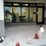 Photo of stuffed animals lined up going into the police station