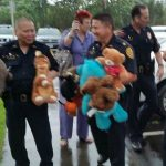 Photo of HPD unloading the stuffed animals from the cars