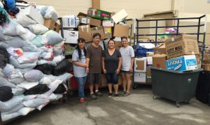 Photo of AILH Oahu staff with Savers' donation load
