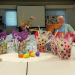 Photo of Women's support group sitting around a conference table with easter baskets in the foreground