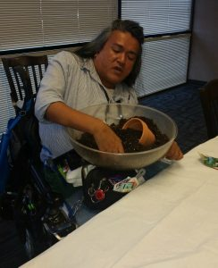 Photo of Oliver mixing a bowl of soil with his hand