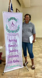 Photo of JulieAnn next to AILH banner