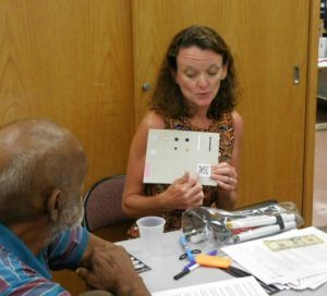 Photo of Kathleen showing Qcode and tactile