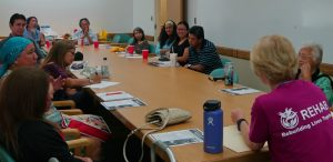 Photo of Hui Malama Po`o group seated around a conference table