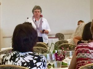 Photo of Kathy Greenlee speaking to audience