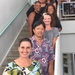 Photo of entire staff standing on stairwell during Staff Training in Hilo