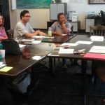 Photo of participants seated around table for Maui Hawaii Fi-Do training
