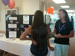 Photo of Kathleen speaking with woman at Kalama Heights Health Fair