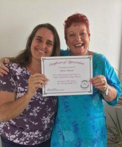Photo of Karin and Sam holding Karin's 2nd anniversary certificate