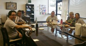Photo of Maui Peer Support Group sitting around conference table