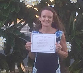 Photo of Kathleen holding certificate