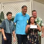 Photo of Roxanne receiving check from Oahu Charity Walk