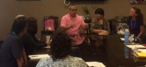 Photo of Maui VI Group seated around conference table