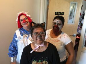Photo of Sam, Gail, and Lani dressed up for Halloween