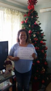 Photo of Lani holding certificate