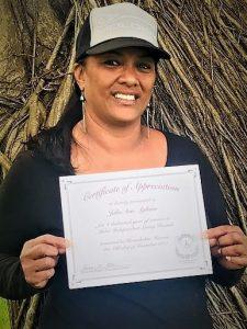 Photo of JulieAnn Agliam holding certificate