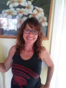 Photo of Pamela wearing her new glasses