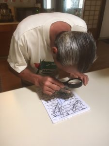 Photo of Anthony using magnifying glass