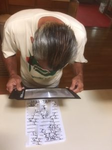 Photo of Anthony using full page magnifier