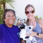 Photo of Lani and woman with stuffed animals
