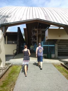 Photo of Kathleen and Rob walking towards building