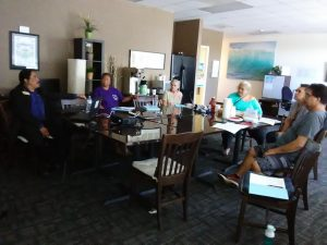 Photo of Maui Support Group Members gathered around a conference table