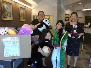 Photo of staff from Territorial Savings Bank with stuffed animals