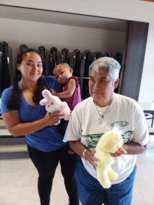 Photo of participants with stuffed animal donations