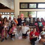Photo of Zumba group holding stuffed animals