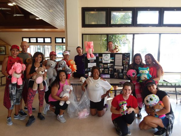 Photo of Zumba group holding stuffed animals