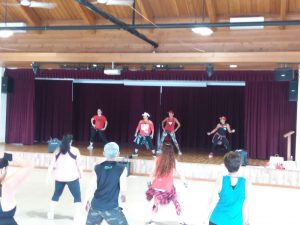 Photo of ZumbaJam instructors leading group in Zumba
