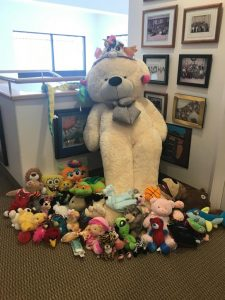 Photo of giant stuffed bear and other stuffed animals