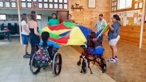 Photo of Hilo youth support group members playing with parachute