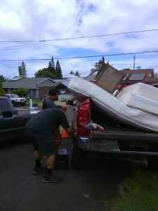 Photo of men unloading items from truck