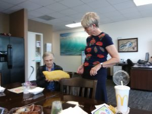 Photo of Dr. Karen Robbins talking with client