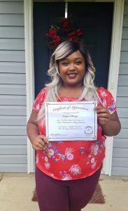 Photo of Leelynn Brady holding certificate