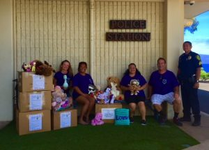 Photo of staff with boxes of Teddy Bears being delivered