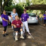 Photo of Lani, Karin, Sam, and consumer at Hilo White Cane Day
