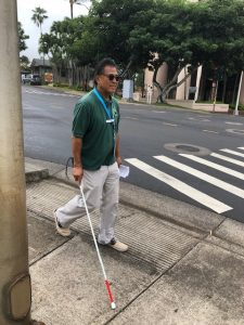 Photo of participant walking using white cane