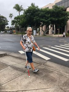 Photo of participant walking with white cane