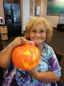 Photo of the winner of a light up pumpkin